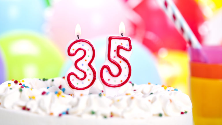 3 and 5 candles on top of a birthday cake for 35th year